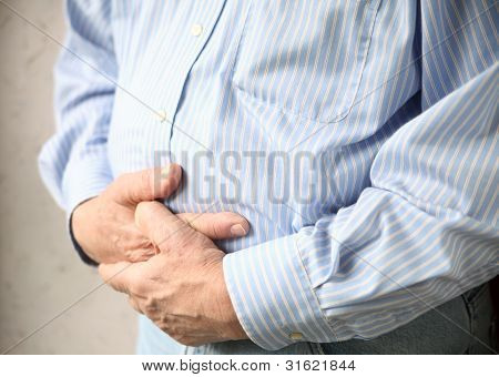 businessman with bad stomach pain