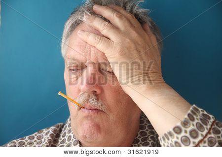 older man has flu symptoms
