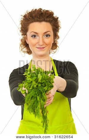 Happy Woman Gives Parsley And Dill