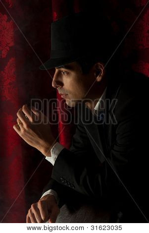 Man With Hat In Darkness