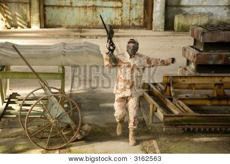 Paintball Player In Abandoned Building
