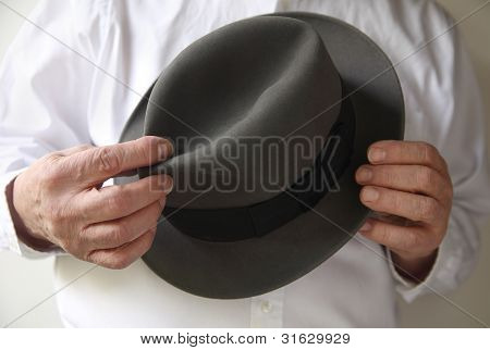 businessman with an old felt hat