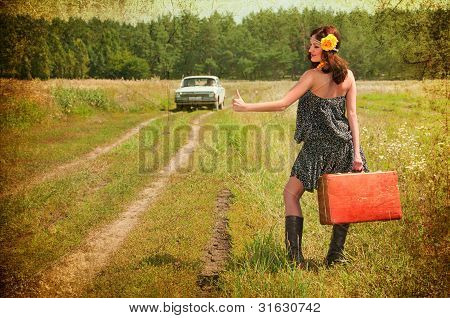 Beautiful Brunette With A Suitcase In The Countryside. Photos In The Old Style.