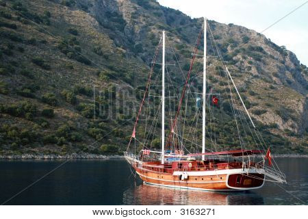 Brown Sailing Boat On The Still Water