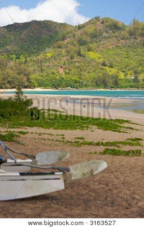 Catamaran Waiting On The Beach