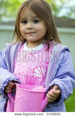 Girl Holding Pink Jug
