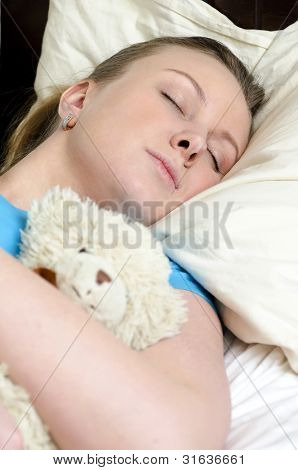 Young Girl Fell Asleep With Teddy Bear