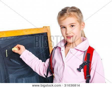 Schoolgirl writing on a blackboard