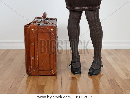 Woman In Brown Stockings Standing Near Vintage Suitcase