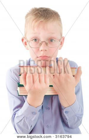Portrait Of Confused Boy Holding Three Books