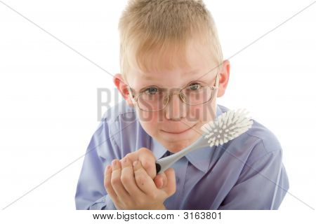 Boy Holding Brush And Prepare To Clean Everywhere