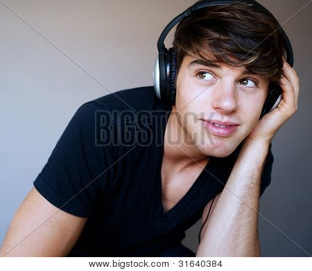 Portrait Of Young Man With Headphones Listening To Music