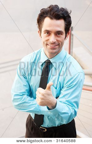 Male Executive Giving Thumbs Up