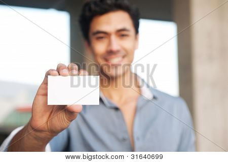 Handsome Businessman Presenting Blank Business Card