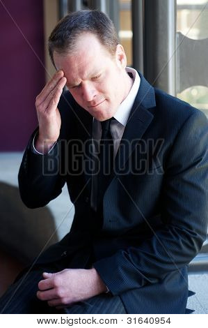 Anxious Businessman With A Headache