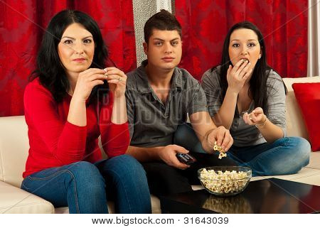 Friends Eating Popcorn At Movie