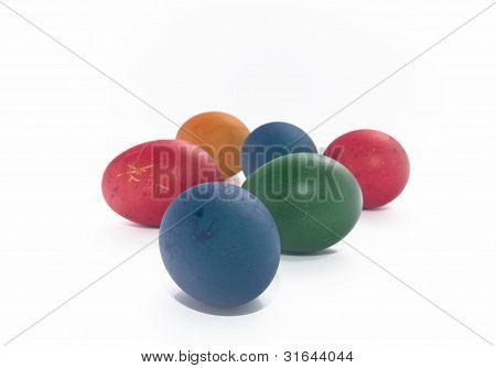 A Lot Of Multi-coloured Painted Eggs Of White Background