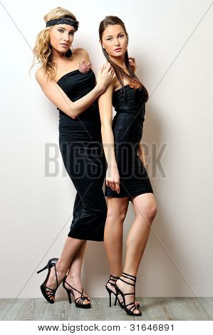 Two Beautiful Women In A Black Dresses.