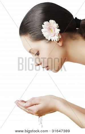 Natural Beauty Portrait Woman With Flower In The Hair
