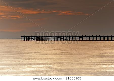 pier in tropic on sunset