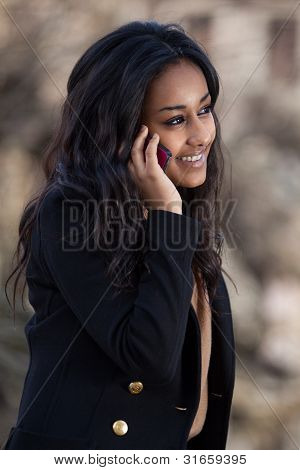 Portrait Of A Happy Young Black  Teenage Girl Using A Mobile Phone
