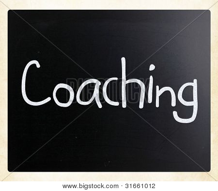 """coaching"" Handwritten With White Chalk On A Blackboard"