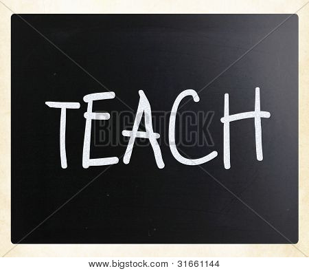"""teach"" Handwritten With White Chalk On A Blackboard"
