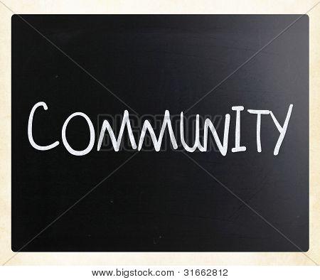 """""""Gemeinschaft"""" Handwritten mit weißer Kreide auf einer Tafel"""