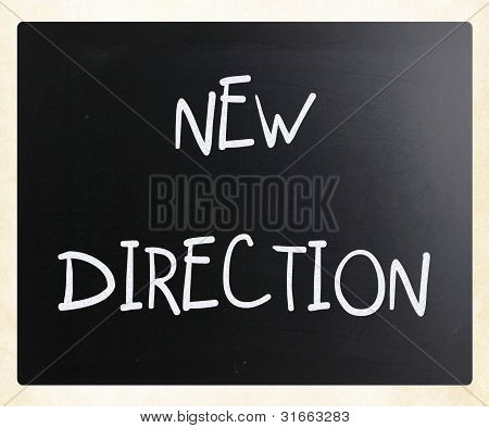 """new Direction"" Handwritten With White Chalk On A Blackboard"