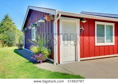 Shed In Purple And Red With Bird Houses.