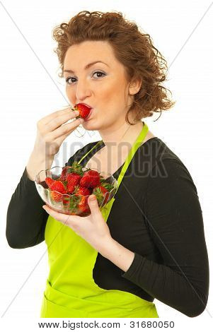 Beauty Redhead Woman Eating Strawberry