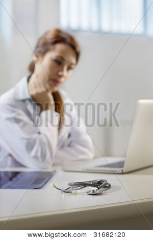 Stethoscope On Desk In Doctor Office