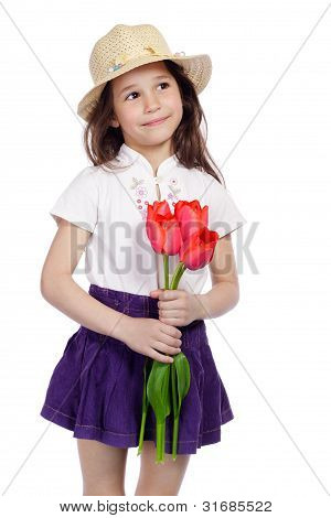 Smiling girl holding a bouquet of tulips