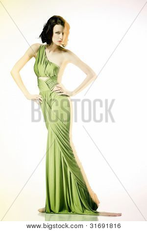 Fashion portrait of brunette lady in long dress shot in mixed light technique