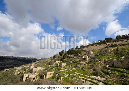 Lifta, a Jerusalem village which was abandoned by the Palestinians during the Israeli War of Independence, juxtaposed against new Israeli high rises.