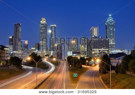 Skyline of Downtown Atlanta, Georgia above Freedom Parkway at twilight.
