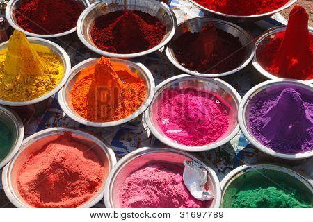 Colored colorful powder kumkum on Indian bazaar for holi festival celebration