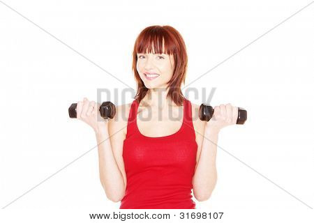 Attractive readhead female lifting weights on white background