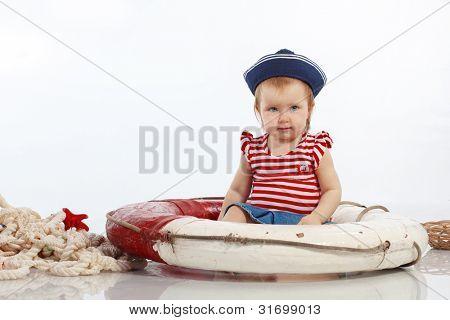 Portrait of little pin-up fashion girl sea theme