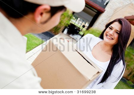 Mailman delivering a parcel at a womans house