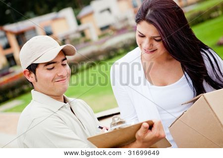 Casual man delivering a package and asking for signature