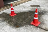 Spilled Water Logged On The Road With Cones. Wet Floor From Rainy Splash Or Pipelines Water Leakage  poster
