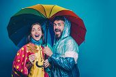 People In Rain. The Autumn Mood And The Weather Are Warm And Sunny And Rain Is Possible. Rain And Um poster