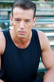 image of bleachers  - portrait of a young athletic man sitting on the bleachers - JPG