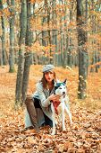 Woman Walking With Husky Dog Autumn Forest. Pedigree Dog Concept. Best Friends. Unconditional Love.  poster