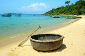 stock photo of coracle  - Picturesque sea landscape with tribal boat - JPG