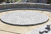 image of sand gravel  - Paving Circle Paver Design in the patio on to sand - JPG