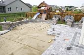 stock photo of sand gravel  - Paving patio on to levelled sand - JPG