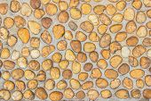 Floor Gravel Pebble Stone On Concrete Wall Background Or Fence Texture Made Of Stone Walls With Colo poster