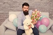 Romantic Man With Flowers And Teddy Bear Sit On Couch Waiting Girlfriend. Romantic Gift. Macho Getti poster